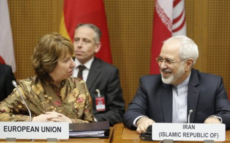 European Union foreign policy chief Catherine Ashton (L) and Iranian Foreign Minister Mohammad Javad Zarif wait for the start of talks in Vienna (Reuters)