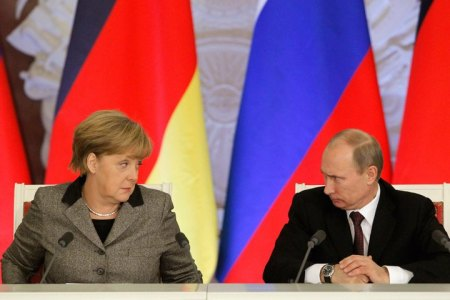 Russian President Vladimir Putin and German Chancellor Angela Merkel answer journalists' questions during a joint news conference in Moscow's Kremlin.(Reuters)